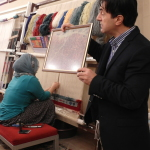Live demonstration of the weaving process of a Turkish Carpet
