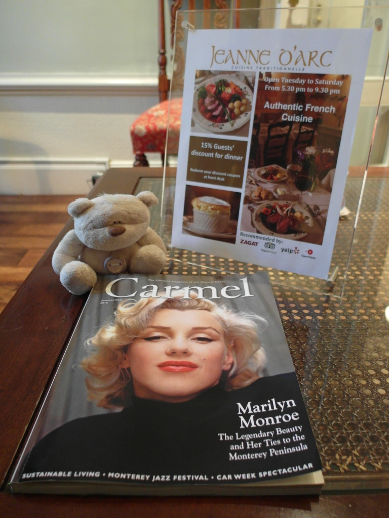 Reading Magazines in the Lobby of Hotel Cornell De France