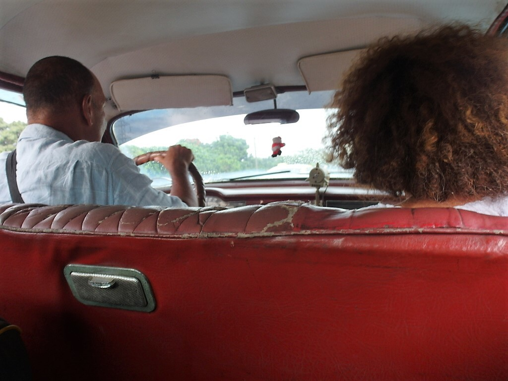 Sitting in a 1950s Chrysler Plymouth in Cuba