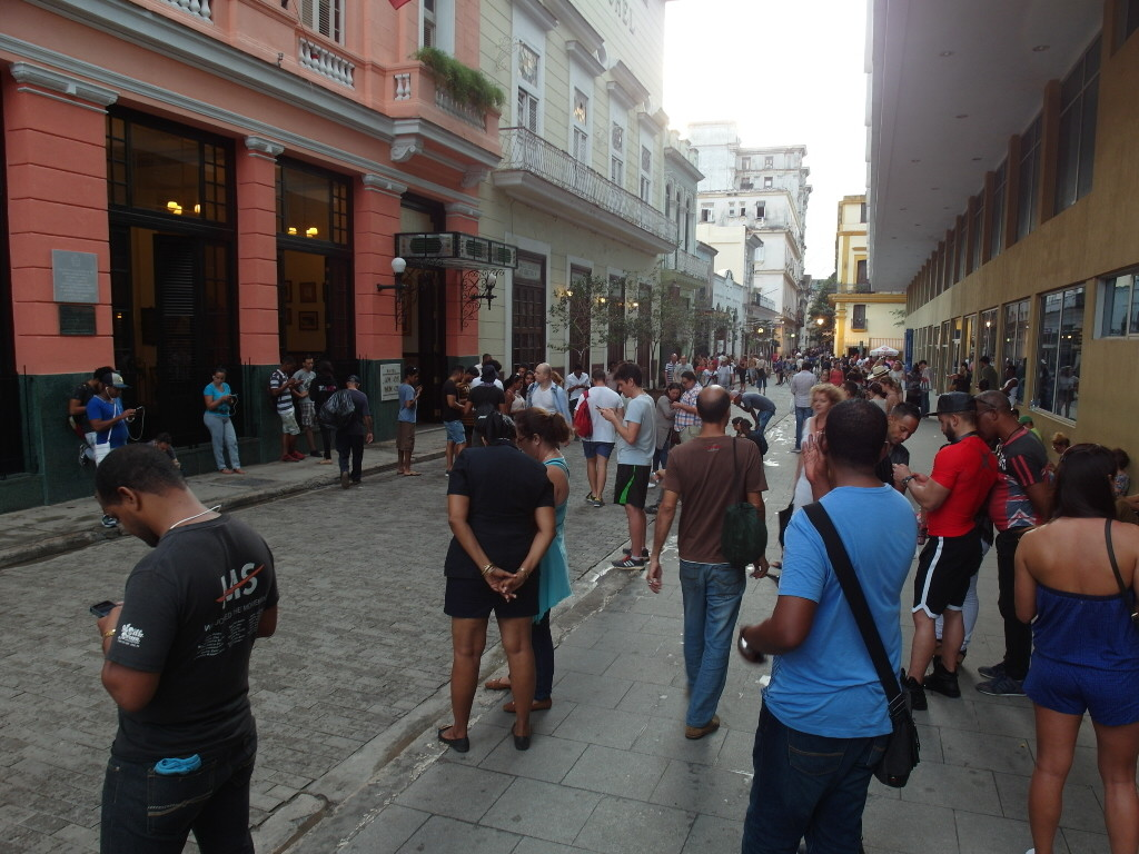 Tourists using Etecsa Wifi Hotspot