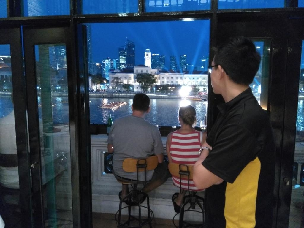 Many guests of Panorama Free Flow Fridays enjoying panoramic views of the Singapore River